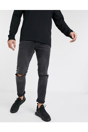 Topman Skinny jeans with knee rips in washed black