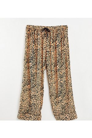 Loungeable Plus woven pyjama bottoms in peach and black spot-Multi