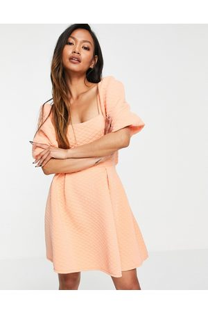 ASOS Quilted puff sleeve cut out ring back aline mini dress in peach-Pink