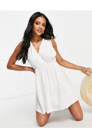 ASOS Recycled gathered detail mini beach dress in white