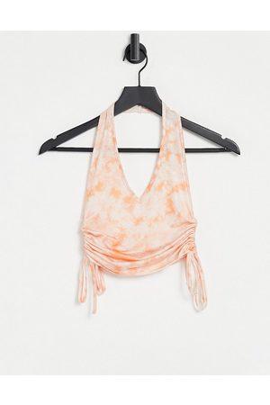 ASOS DESIGN Slinky halter top with ruched sides in orange tie dye
