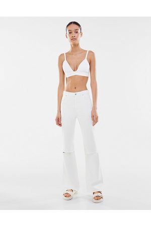 Bershka Ripped stretch flare jean in white