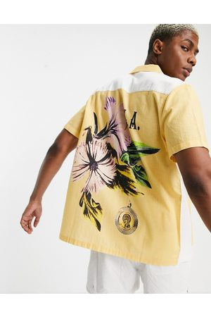 ASOS Relaxed revere shirt with cut and sew back placement floral-Yellow