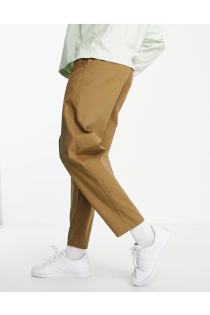 ASOS Oversized tapered fit chinos in brown