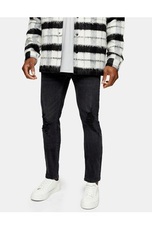 Topman Skinny jeans with rip in washed black