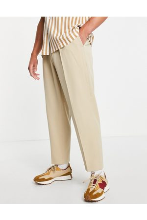 ASOS DESIGN Oversized tapered smart trousers in stone-Neutral