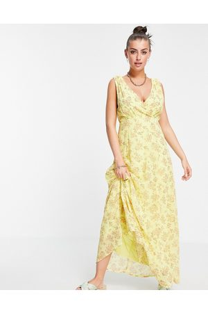 VILA Maxi dress with wrap front detail in yellow floral-Multi