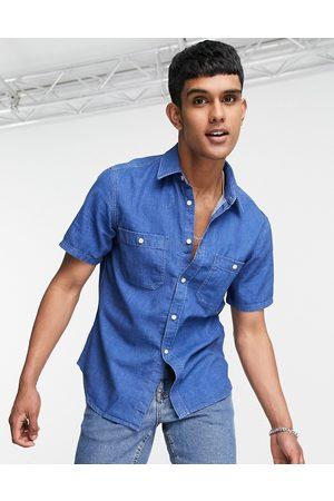 Tommy Hilfiger Short sleeve denim shirt in mid wash blue