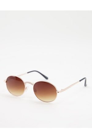 Jeepers Peepers Ženy Sluneční brýle - Womens round sunglasses with nose and arm detail in gold