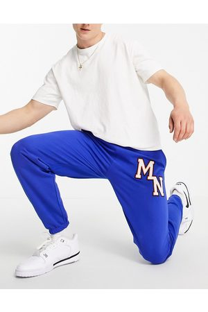 Mennace Joggers in blue with collegiate embroidery