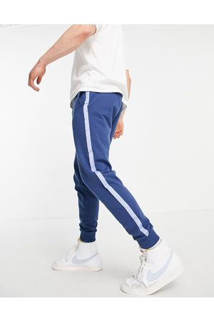 ASOS Muži Tepláky - Co-ord oversized joggers with blocking and numeral tape-Navy