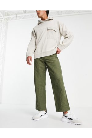 ASOS DESIGN Wide fit trousers in heavy wash in khaki-Green