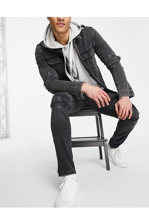 Topman Organic cotton rip and repair skinny jeans in washed black