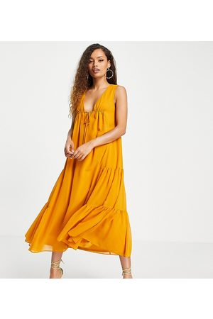 ASOS ASOS DESIGN Petite sleeveless trapeze maxi dress with tie detail and side tiers-Yellow
