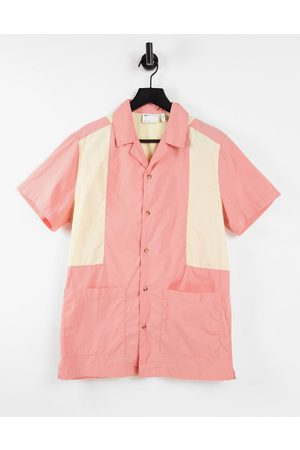 ASOS Cut and sew bowling shirt with revere collar in pink
