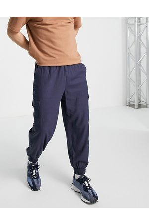 ASOS Linen mix oversized tapered trousers with cargo pockets in navy
