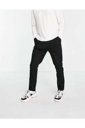 ASOS Skinny chinos with elastic waist in black