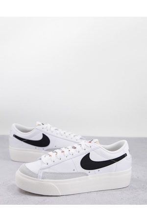Nike Blazer Low Platform trainers in white and yellow