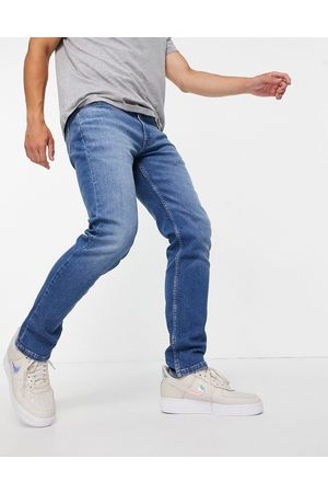 Levis Levi's 511 slim fit stretch jeans in begonia overt adv mid wash-Blue