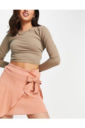 ASOS Wrap mini skirt in natural crinkle in terracotta-Orange
