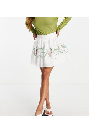 Reclaimed Inspired mini skirt with cross stitch embroidery in white co-ord