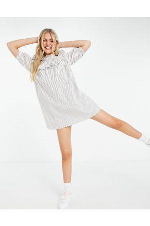 Influence Ruffle bib mini dress in polka dot-White
