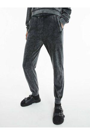 Calvin Klein Ženy Tepláky - Dámské tmavě šedé tepláky