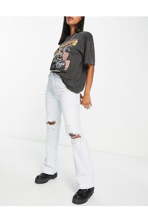 Bershka Flare jean with knee rip in light blue