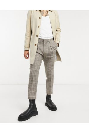 ASOS Tapered smart trousers in check with double pleat-Stone