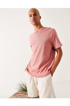 ASOS Relaxed fit short sleeve waffle t-shirt with grandad collar in pink