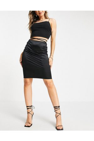Flounce London Satin midi skirt with strap details in black