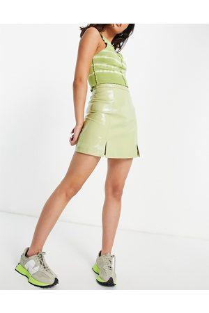 Muubaa Slit front leather mini skirt in patent green