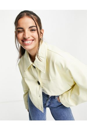 ASOS Cropped faux leather jacket in buttermilk-Yellow