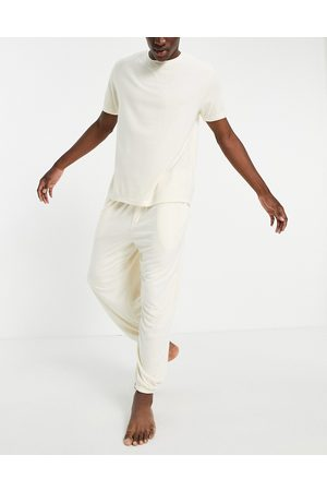 ASOS Fluffy pyjama set with oversized jogger and t-shirt in beige-Neutral