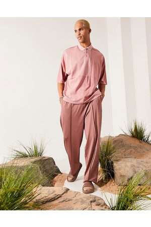 ASOS Oversized polo in washed pink with waffle