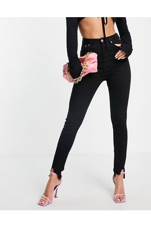 NA-KD Super high waisted jeans with asymmetrical hem in black