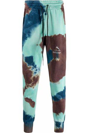 MAUNA KEA Tie-dye logo-print trackpants