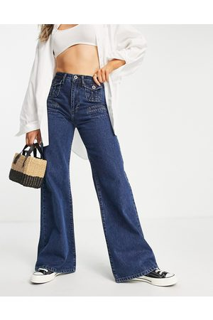 French Connection 70's flared jean in mid blue wash