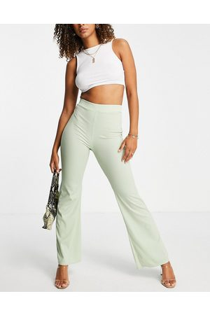 Club L Ribbed flare trousers in green co-ord
