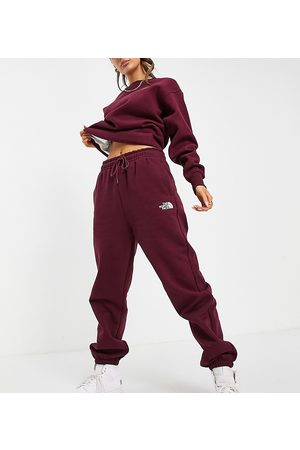 The North Face Ženy Teplakovka - Tight joggers in burgundy Exclusive at ASOS-Red