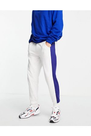 ASOS Co-ord oversized joggers with printed side stripe-White