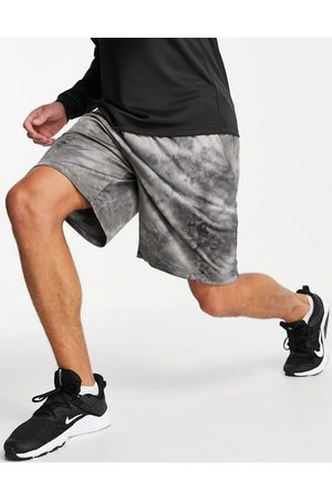 ASOS 4505 Jersey training shorts with tie dye-Brown