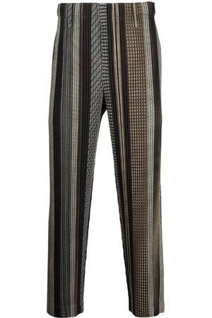HOMME PLISSÉ ISSEY MIYAKE Striped plissé trousers