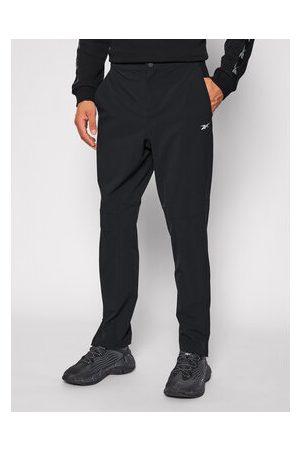 Reebok Muži Tepláky - Teplákové kalhoty