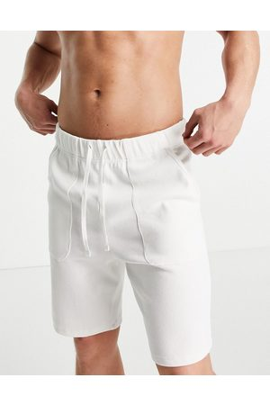 ASOS Relaxed knitted look lounge shorts in off-white