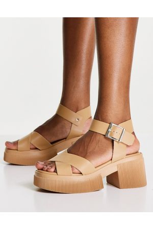 ASOS DESIGN Hebe chunky cross strap mid heeled sandal in beige-Neutral