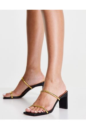 ASOS DESIGN Hamilton mid heeled mules in black and gold