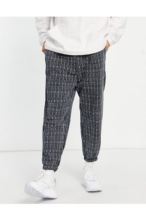 ASOS DESIGN Oversized joggers in all over Chicago print in black