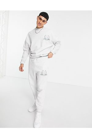 ASOS Co-ord oversized joggers with logo print in white marl