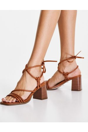 ASOS DESIGN Hollow strappy tie leg mid heeled sandals in tan-Brown